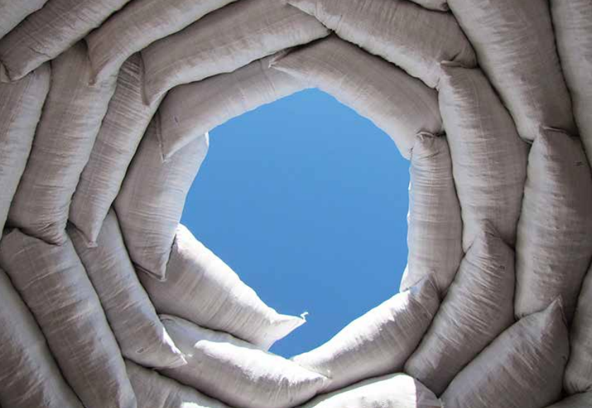 2.1: Looking straight up inside an earthbag dome shows the spiraling pattern of bags closing in to cap the dome. This was a small, mostly underground dome with earthen fill situated in the desert southwestern United States. Credit: Kelly Hart