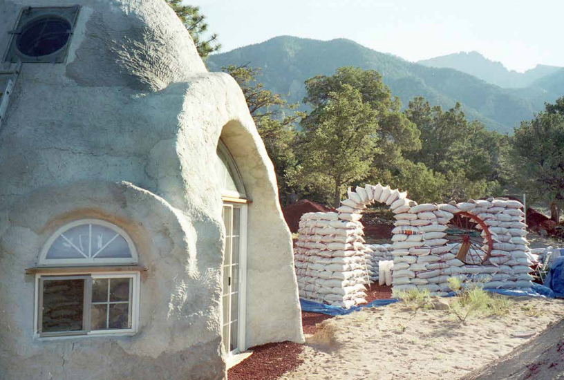 The author's earthbag dome home under construction in 1999